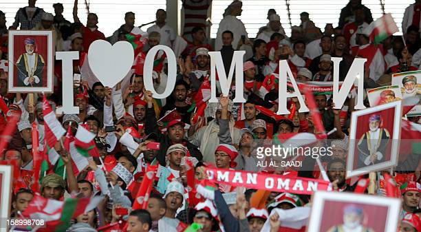Omani supporters hold giant letters reading 'I live Oman' prior the sart of the opening ceremony and football match between Bahrain and Oman in the...