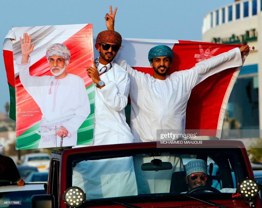 Omanis hold a placard bearing a portrait of their leader Sultan Qaboos bin Said, who flew home the previous day after he spent more than eight months in Germany for medical treatment, during celebrations in the capital Muscat on March 24, 2015. Qaboos, is the longest serving leader in the Middle East and the only one many Omanis have ever had.