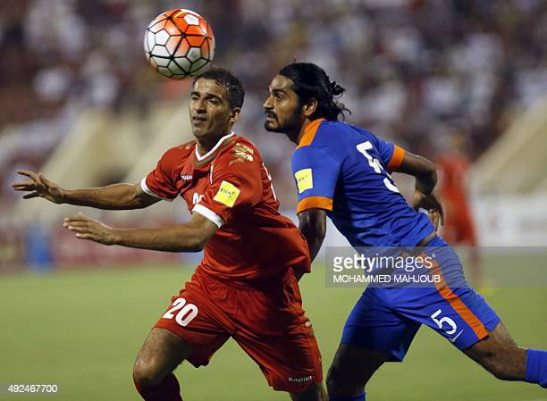 Oman's Emad alHosni fights for the ball against India's Sandesh Jhingan during the AFC qualifying football match for the 2018 FIFA World Cup between...