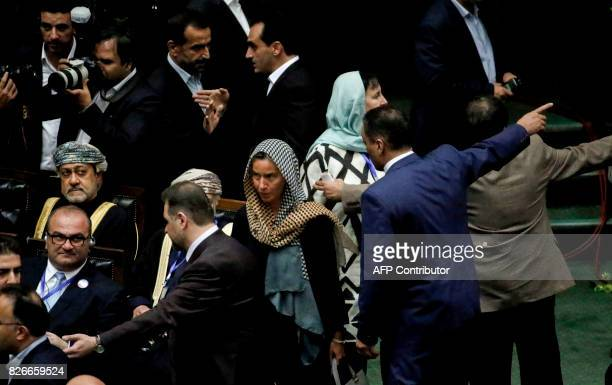Oman's Minister of Heritage and Culture Haitham bin Tariq Al Said sits as EU foreign policy chief Federica Mogherini arrives for the swearing in of...