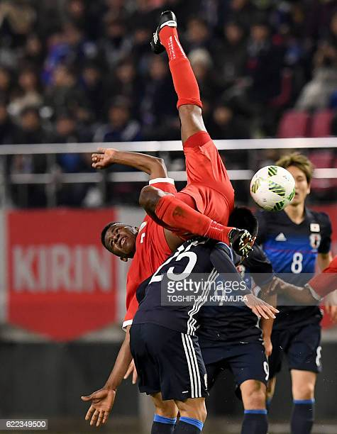 Oman's Nadir Awadh Bait Mabrook fights for the ball with Japan's Yuya Kubo during their football friendly match in Kashima Ibaraki prefecture on...