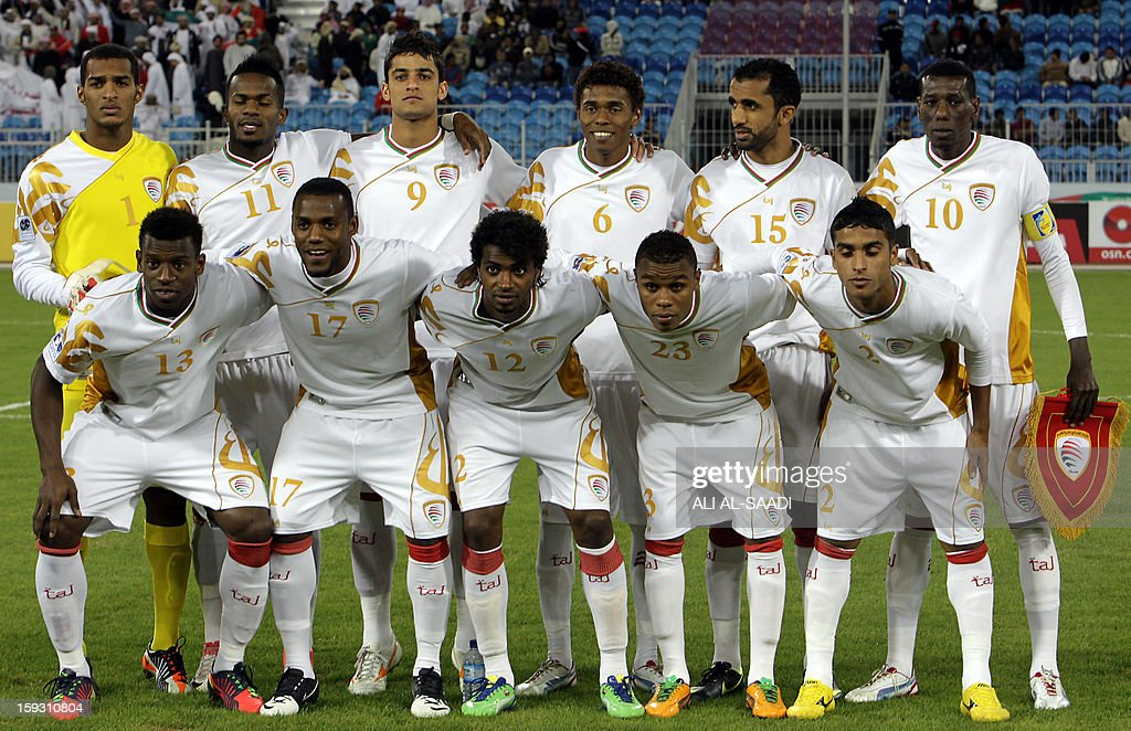 Oman's national football team players pose for a group picture before their 21st Gulf Cup football match against UAE in the Bahraini capital Manama on January 11, 2013. AFP PHOTO/ALI AL-SAADI