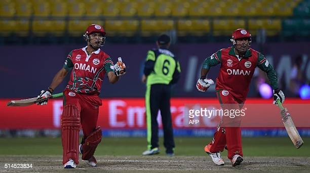 Oman's Oman's Munis Ansari and Ajay Lalcheta react after their team's victory in the World T20 cricket tournament match between Ireland and Oman at...