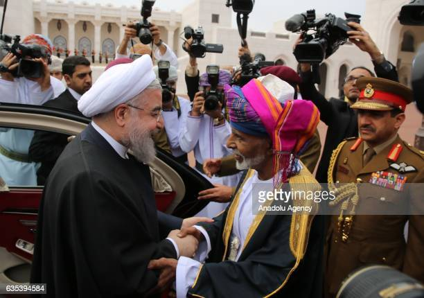 Oman's Sultan Qaboos Bin Said Al Said welcomes Irans President Hassan Rouhani with official welcome ceremony before their meeting in Muscat Oman on...