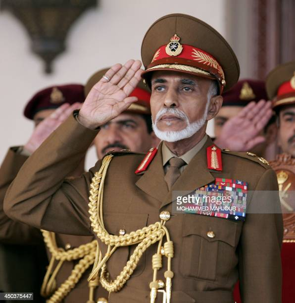 Oman's Sultan Qaboos bin Said salutes during the military parade in the capital Muscat marking the Sultanates 43th National Day on November 18 2013...