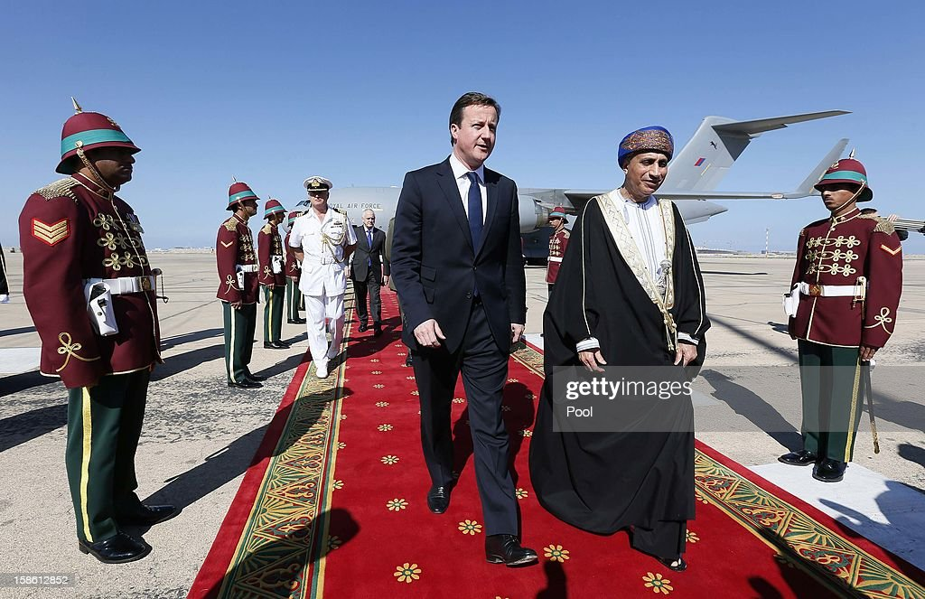 Oman's Sultan Qaboos bin Said walks with Britain's Prime Minister <a gi-track='captionPersonalityLinkClicked' href=/galleries/search?phrase=David+Cameron+-+Politician&family=editorial&specificpeople=227076 ng-click='$event.stopPropagation()'>David Cameron</a> after his arrival on December 21, 2012 in Muscat, Oman. Cameron's visit to Oman comes as Aerospace and defence company BAE systems agree a 2.5 billion GBP deal with Oman for 12 Typhoon fighter jets and eight Hawk aircrafts and comes hot on the heels of his Christmas visit to British troops in Afghanistan.