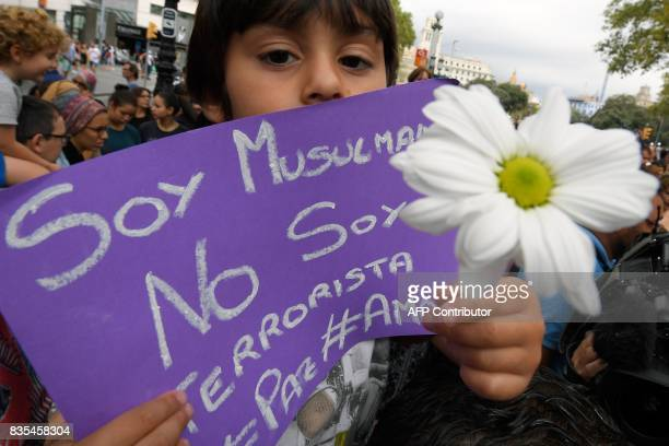 Omar 4 yearold holds a message reading 'I a Muslim not a terrorist' as Muslim residents of Barcelona demonstrate on the Las Ramblas boulevard in...