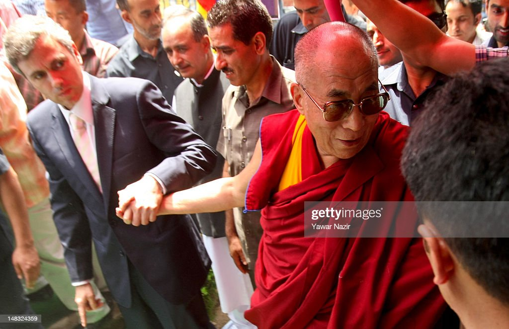 Omar Abdullah, chief minister of Jammu and Kashmir (L) holds the hand of Tibetan spiritual leader the Dalai Lama during his visit to a Tibetan school on July 14, 2012 in Srinagar the summer capital of Indian administered Kashmir, Indian. The Dalai Lama is in Kashmir for about a week to visit the Tibetan community living in the predominately Muslim area.