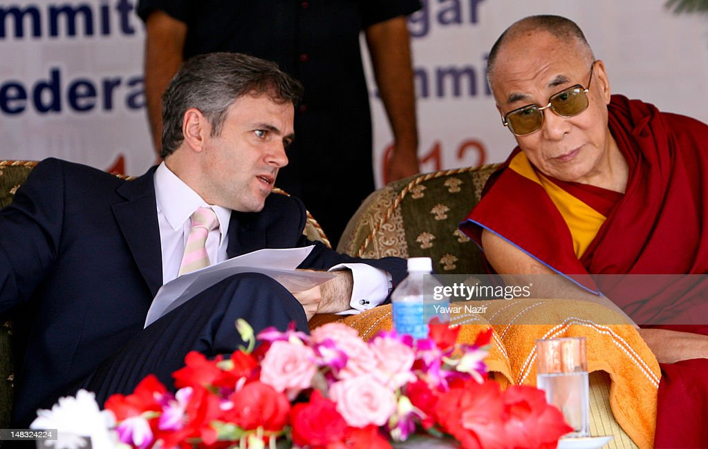 Omar Abdullah, chief minister of Jammu and Kashmir (L) listens to Tibetan spiritual leader the Dalai Lama gestures during his visit to a Tibetan school on July 14, 2012 in Srinagar the summer capital of Indian administered Kashmir, Indian. The Dalai Lama is in Kashmir for about a week to visit the Tibetan community living in the predominately Muslim area.