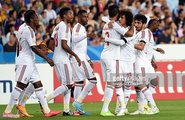 Omar Abdulrahman congratulates Ali Mabkhout of UAE after his first goal during the Asian Cup quarterfinal football match between Japan and the UAE in...