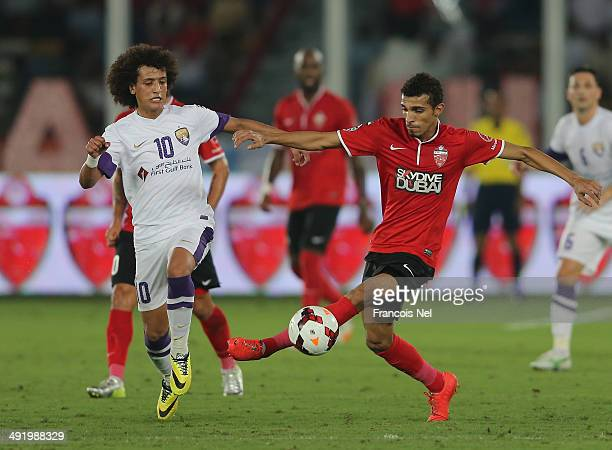 Omar Abdulrahman of Al Ain competes for the ball with Abdulrahman Yousif of Al Ahli during the Presidents Cup Final match between Al Ain and Al Ahli...