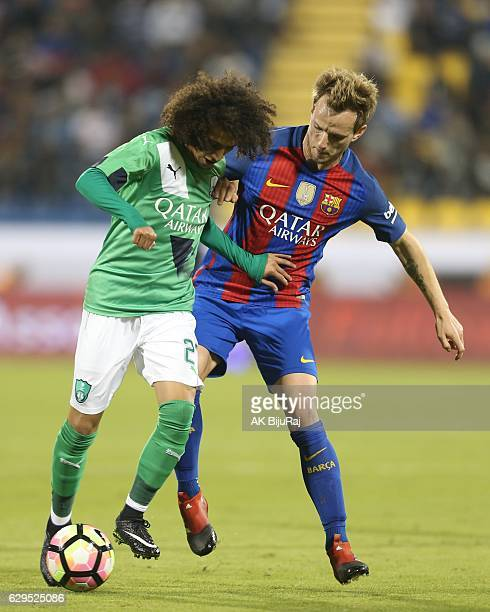 Omar Abdulrahman of AlAhli Saudi FC in action against Ivan Rakitic of Barselona during the Qatar Airways Cup match between FC Barcelona and AlAhli...