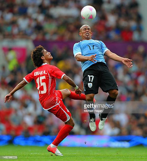 Omar Abdulrahman of the UAE in action with Egidio Arevalo during the Men's Football first round Group A Match of the London 2012 Olympic Games...