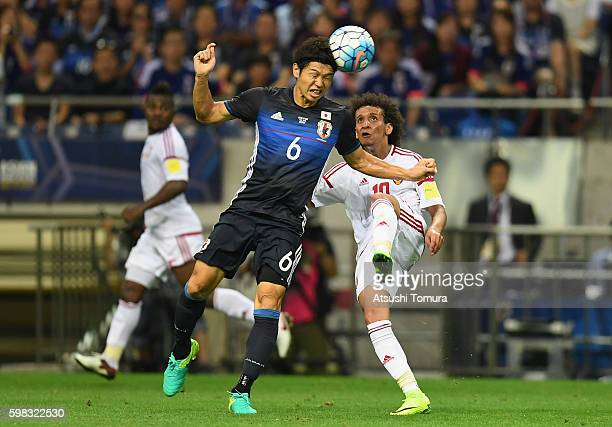Omar Abdulrahman of the United Arab Emirates and Masato Morishige of Japan compete for the ball during the 2018 FIFA World Cup Qualifier Final Round...