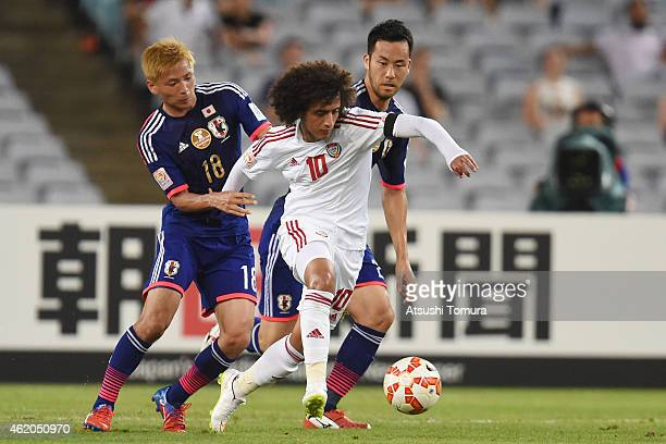 Omar Abdulrahman of the United Arab Emirates competes with Takashi Inui of Japan during the 2015 Asian Cup Quarter Final match between Japan and the...