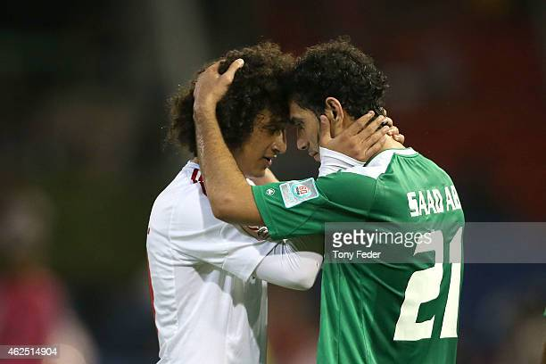Omar Abdulrahman of the United Arab Emirates consoles Saad Abdulameer of Iraq after the Third Place 2015 Asian Cup match between Iraq and the United...