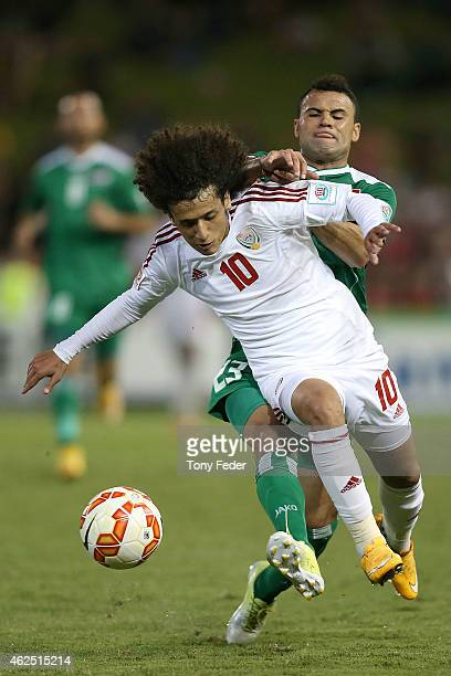 Omar Abdulrahman of the United Arab Emirates contests the ball with Waleed Salim of Iraq after the Third Place 2015 Asian Cup match between Iraq and...
