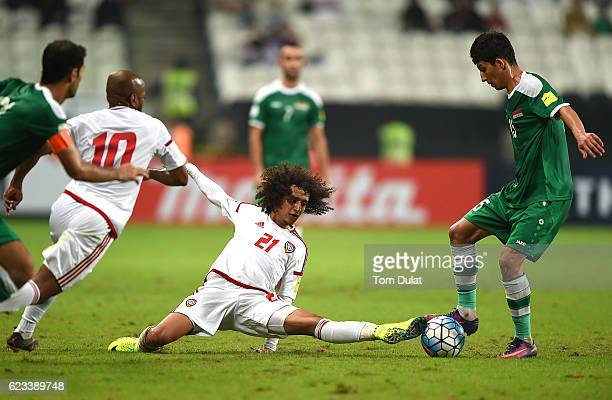 Omar Abdulrahman of UAE and Dhurgham Ismael Dawood of Iraq battle for the ball during the 2018 FIFA World Cup Qualifier match between UAE and Iraq at...