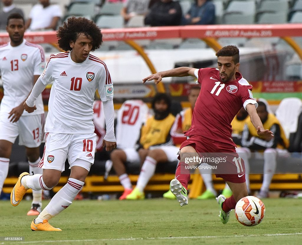 <a gi-track='captionPersonalityLinkClicked' href=/galleries/search?phrase=Omar+Abdulrahman&family=editorial&specificpeople=6420654 ng-click='$event.stopPropagation()'>Omar Abdulrahman</a> (L) of UAE fights for the ball with Hasan Al Haydos (R) of Qatar during the Group C Asian Cup football match between UAE and Qatar in Canberra on January 11, 2015.