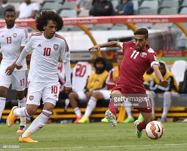 Omar Abdulrahman of UAE fights for the ball with Hasan Al Haydos of Qatar during the Group C Asian Cup football match between UAE and Qatar in...