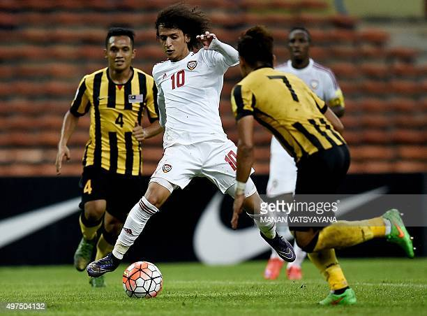 Omar Abdulrahman of UAE vies for the ball with Muhammad Fazly and Mohamad Aidil Zafuan of Malaysia during the 2018 FIFA World Cup qualifying football...