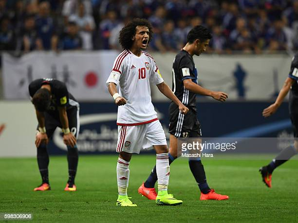 Omar Abdulrahman of United Arab Emirates celebrates the win during the 2018 FIFA World Cup Qualifiers Group B match between Japan and United Arab...