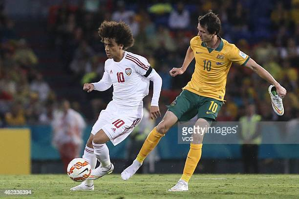 Omar Abdulrahman of United Arab Emirates competes with Robbie Kruse of Australia during the Asian Cup Semi Final match between the Australian...