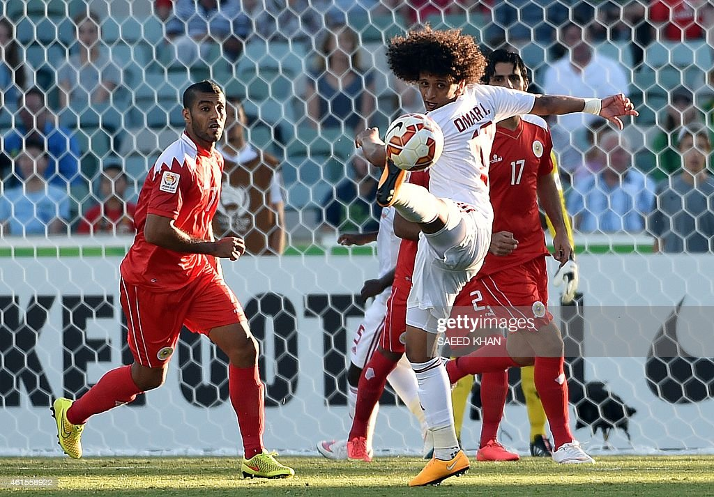 <a gi-track='captionPersonalityLinkClicked' href=/galleries/search?phrase=Omar+Abdulrahman&family=editorial&specificpeople=6420654 ng-click='$event.stopPropagation()'>Omar Abdulrahman</a> (C) of United Arab Emirates fights for the ball with Bahrain's Abdulwahab Ali Alsafi (L) during the Asian Cup football match between Bahrain and United Arab Emirates in Canberra on January 15, 2015. AFP PHOTO / Saeed Khan USE --