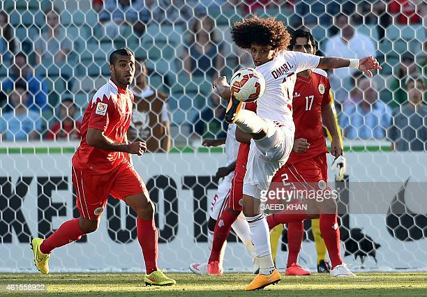 Omar Abdulrahman of United Arab Emirates fights for the ball with Bahrain's Abdulwahab Ali Alsafi during the Asian Cup football match between Bahrain...