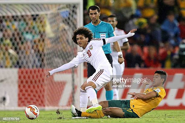 Omar Abdulrahman of United Arab Emirates is tackled by Massimo Luongo of the Socceroos during the Asian Cup Semi Final match between the Australian...