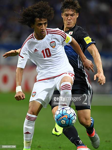 Omar Abdulrahman of United Arab Emirates#10 and Gotoku Sakai of Japan compete for the ball during the 2018 FIFA World Cup Qualifiers Group B match...