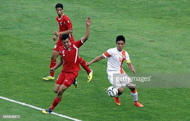 Omar Ahmad Mustafa Almannasrah of Jordan battles with Sunil Chhetri of India during the Football Mens Group G match between India and Jordan during...