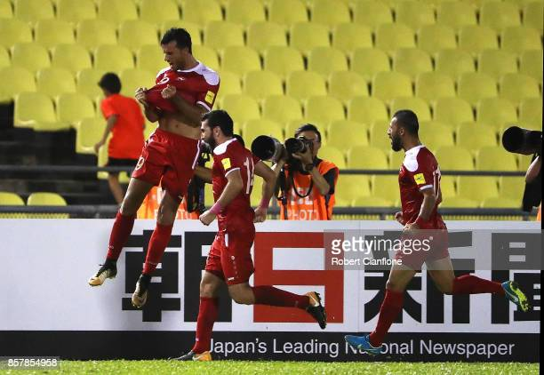 Omar Alsoma of Syria celebrates after scoring a goal during the 2018 FIFA World Cup Asian Playoff match between Syria and the Australia Socceroos at...