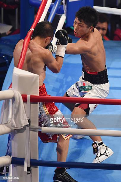 Omar Andres Narvaez of Argentina and Naoya Inoue of Japan exchange punches during the WBO World Super Flyweight Title bout between Omar Andres...