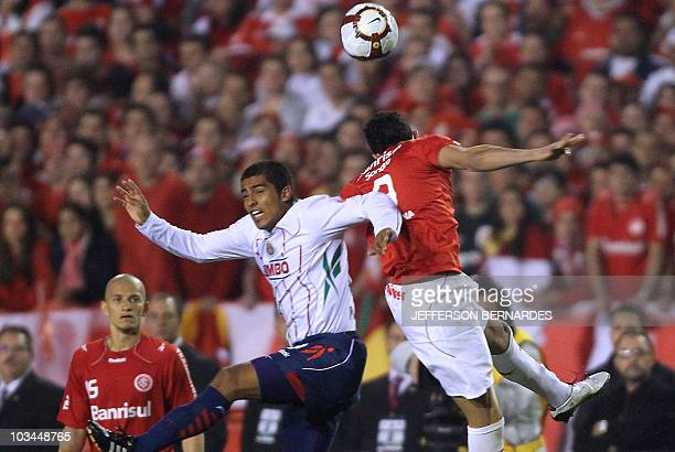 Omar Arellano of Mexico's Chivas vies for the ball with Nei and Bolivar of Brazilian Internacional during their Libertadores Cup final match at Beira...