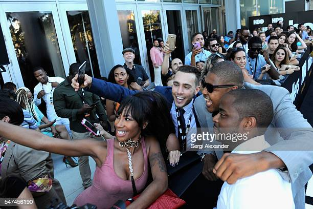 Omar Benson Miller and Dule Hill pose with fans at the HBO Ballers Season 2 Red Carpet Premiere and Reception on July 14 2016 at New World Symphony...