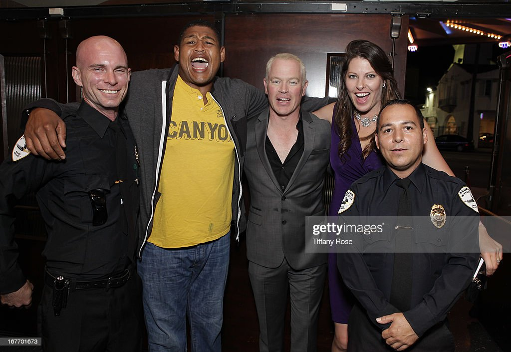 Omar Benson Miller, <a gi-track='captionPersonalityLinkClicked' href=/galleries/search?phrase=Neal+McDonough&family=editorial&specificpeople=213199 ng-click='$event.stopPropagation()'>Neal McDonough</a>, Ruve McDonough and police officers attend Los Angeles Police Memorial Foundation's Celebrity Poker Tournament at Saban Theatre on April 27, 2013 in Beverly Hills, California.