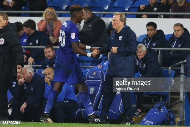 Omar Bogle of Cardiff City shakes hands with Cardiff City manager Neil Warnock during the Sky Bet Championship match between Cardiff City and Ipswich...