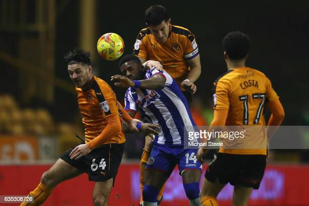 Omar Bogle of Wigan is crowded out by Danny Batth Ben Marshall and Helder Costa of Wolverhampton during the Sky Bet Championship match between...