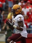 Omar Bolden of the Arizona State Sun Devils returns a kickoff for a touchdown against the Wisconsin Badgers at Camp Randall Stadium on September 18...