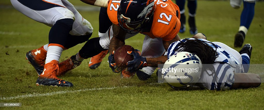 Omar Bolden of the Denver Broncos hits Josh Cribbs of the Indianapolis Colts hard and the ball comes loose Andre Caldwell of the Denver Broncos picks...