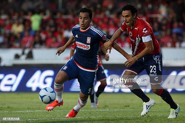 Omar Bravo of Chivas and Leobardo Lopez of Veracruz fight for the ball during a 1st round match between Veracruz and Chivas as part of the Apertura...