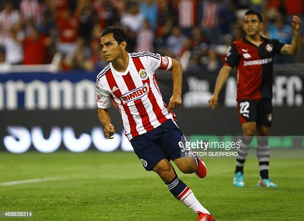 Omar Bravo of Chivas celebrates after scoring against Atlas during their Mexican Clausura 2015 tournament football match at Jalisco stadium in...
