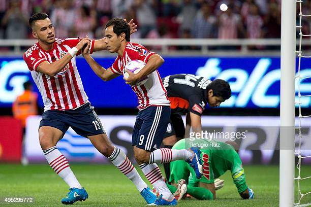 Omar Bravo of Chivas celebrates after scoring the fourth goal of his team during the 15th round match between Chivas and Pachuca as part of the...