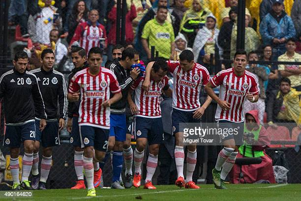 Omar Bravo of Chivas celebrates after scoring the second goal of his team during a 10th round match between America and Chivas as part of the...
