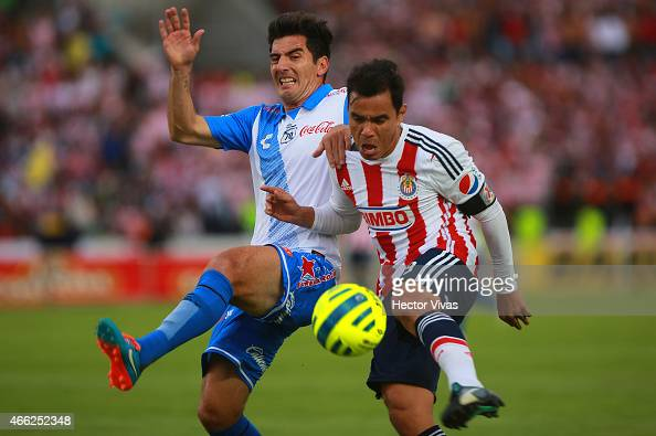 Omar Bravo of Chivas struggles for the ball with Facundo Erpen of Puebla during a match between Puebla and Chivas as part of 10th round Clausura 2015...