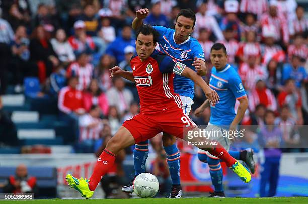 Omar Bravo of Chivas struggles for the ball with Omar Mendoza of Cruz Azul during the 2nd round match between Cruz Azul and Chivas as part of the...