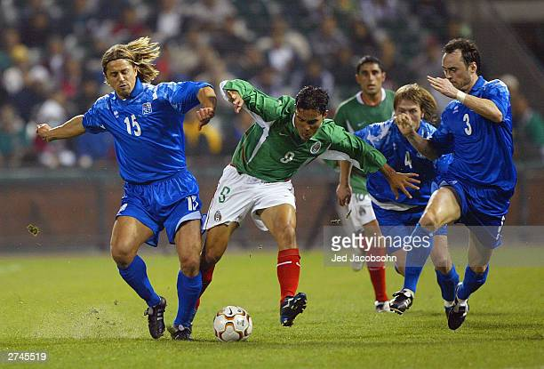 Omar Bravo of Mexico battles for the ball against Helgi Kolvidsson of Iceland during a game on November 19 2003 at Pac Bell Park in San Francisco...