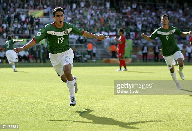 Omar Bravo of Mexico celebrates after scoring the opening goal during the FIFA World Cup Germany 2006 Group D match between Mexico and Iran at the...