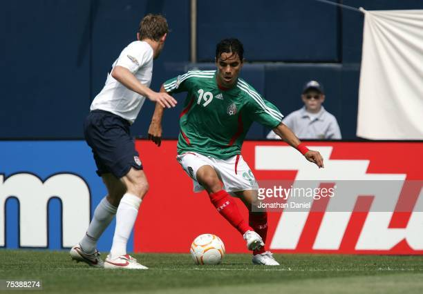 Omar Bravo of Mexico moves the ball against Jonathan Spector of the USA during the CONCACAF Gold Cup Final match at Soldier Field on June 24 2007 in...